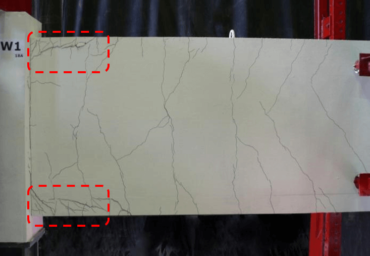 Tensile cracks along inadequate lap splices at the base of shear wall - Reversed cyclic loading